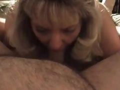 Aged golden-haired wife blows chubby hubby