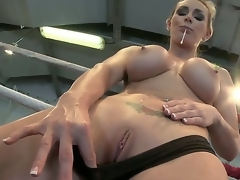 Busty honey Tanya gets so horny and gives a decision to masturbate in a wrestling ring