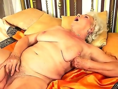 Granny with greatly hairy slit named Norma rubs it with a new toy in the afternoon
