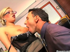 Donna Bell is looking really intimidating with her thick rimmed glasses, but behind that bossy appearance lies a floozy ready to fuck her employee during working hours!