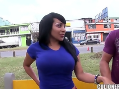 Black haired large ass provocative sexy milf Sandra with pretty face acts like wench during the time that getting filmed outdoor and enjoys revealing her biggest fake tits in public in close up.