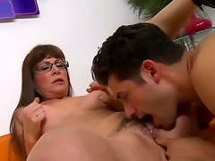 Brunette hair milf with long hair and glasses Alexandra Silk gets her hirsute cum-hole licked and fingered by a turned on man Giovanni Francesco on the couch i the living room and enjoys
