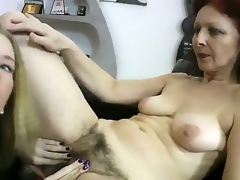 Gorgeous and sweet golden-haired hottie Angel Hott truly has fun in this hot and passionate lesbo sex session with a enormous chested and hariy milf on the sofa in the living room