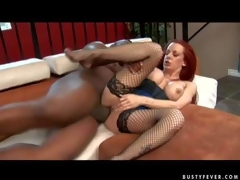 Experienced curvy redhead milf Shannon Kelly with big fake balloons and bouncing arse in fishnet stockings acquires her shaved minge pounded hard by tall black hunk to loud agonorgasmos