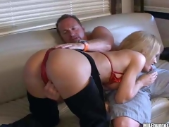 Busty mature blonde momma with big boobs in sexy cowgirl panties and red bikini enjoys in teasing her lover and giving head on the ottoman in front of the cam