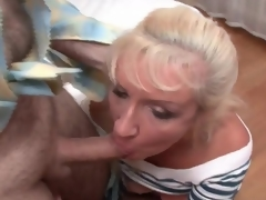 Mature bitch in fishnets and petticoat sucks cocks