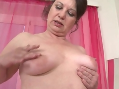 Mature fondles her big butt and saggy meatballs