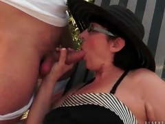 Horny aged sucks penis outdoors