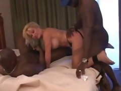 mature floozy bitch with two black chaps