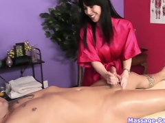 Brunette hair masseuse with big whoppers works his cock like a porn star