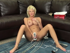 Busty golden-haired Joslyn toys her pussy and vibrates her clit on the couch, then receives on the floor